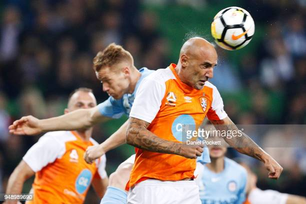 Massimo Maccarone of Brisbane Roar heads the ball during the ALeague Elimination Final match between the Melbourne City and the Brisbane Roar at AAMI...