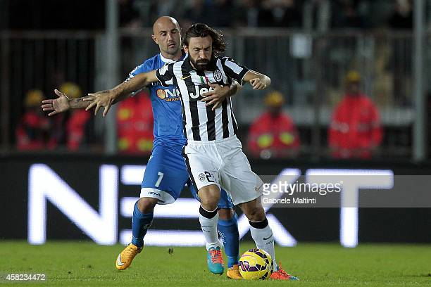 Massimo Maccarone of Empoli FC battles for the ball with Andrea Pirlo of Juventus FC during the Serie A match between Empoli FC and Juventus FC at...