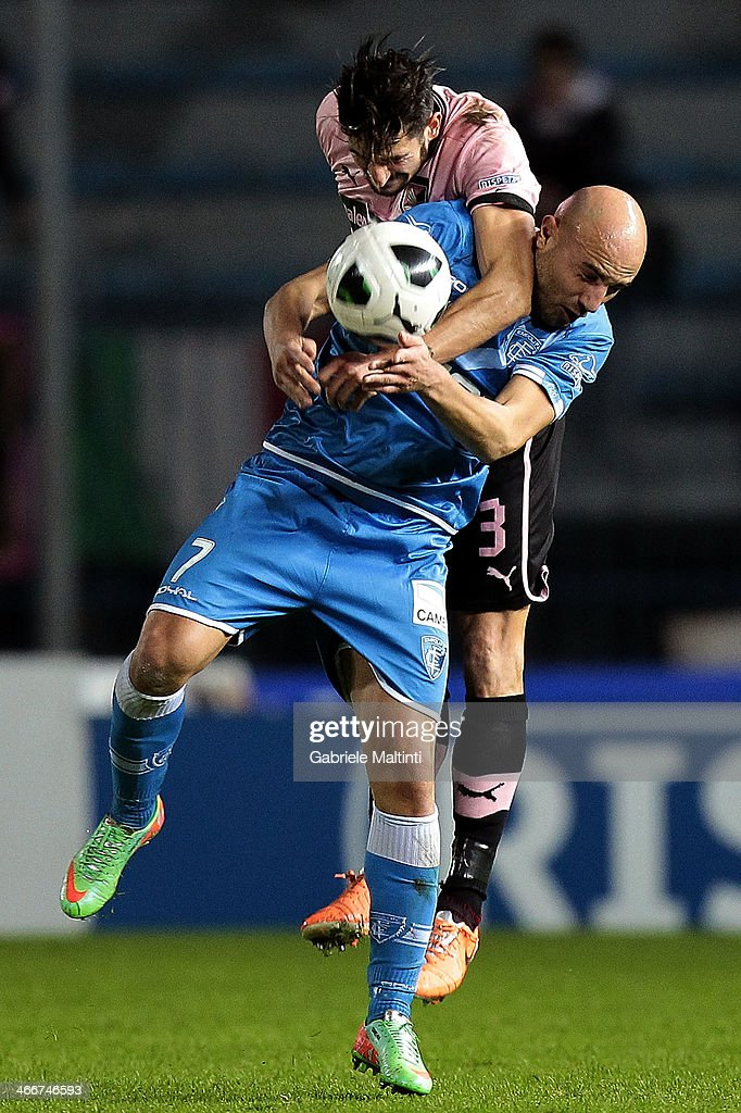 Massimo Maccarone of Empoli Fc battles for the ball with Eros Pisano of US Citta di Palermo during the Serie B match between Empoli FC and US Citta di Palermo at Stadio Carlo Castellani on February 3, 2014 in Empoli, Italy.