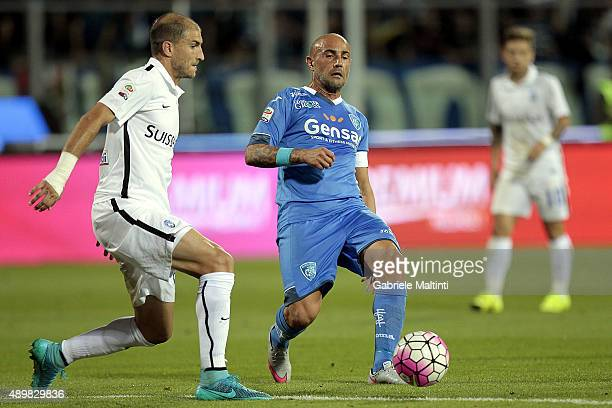 Massimo Maccarone of Empoli FC battles for the ball with Gabriel Paletta of AC Atalanta BC during the Serie A match between Empoli FC and Atalanta BC...