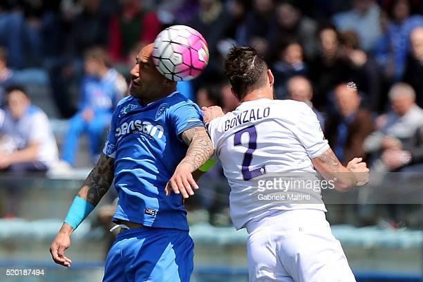 Massimo Maccarone of Empoli FC battles for the ball with Gonzalo Rodriguez of ACF Fiorentina during the Serie A match between Empoli FC and ACF...