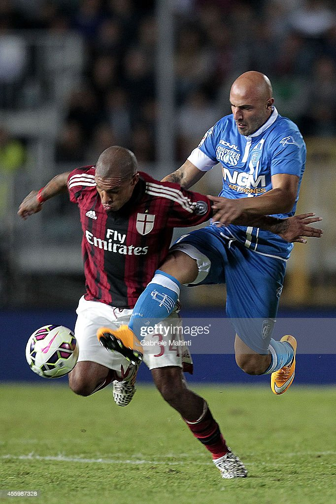 Massimo Maccarone of Empoli Fc battles for the ball with Nigel De Jong of AC Milan during the Serie A match between Empoli FC and AC Milan at Stadio Carlo Castellani on September 23, 2014 in Empoli, Italy.