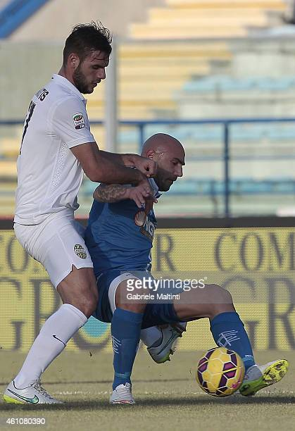 Massimo Maccarone of Empoli FC battles for the ball with Panagiotis Tachtsidis of Hellas Verona FC during the Serie A match between Empoli FC and...