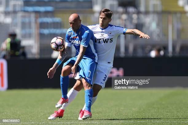 Massimo Maccarone of Empoli FC battles for the ball with Rafael Toloi of Atalanta BC during the Serie A match between Empoli FC and Atalanta BC at...