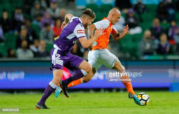 Massimo Maccarone of the Brisbane Roar runs the ball out of defense during the round 27 ALeague match between the Perth Glory and the Brisbane Roar...