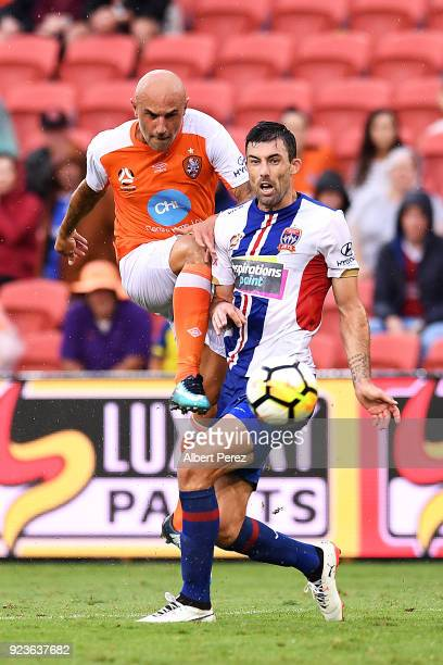 Massimo Maccarone of the Roar and Jason Hoffman of the Jets challenge for the ball during the round 21 ALeague match between the Brisbane Roar and...