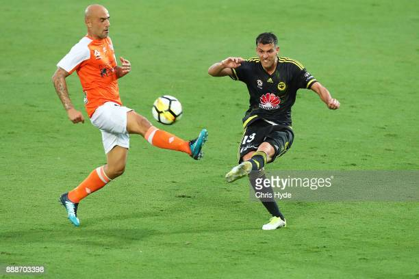 Massimo Maccarone of the Roar and Marco Rossi of the Phoenix compete for the ball during the round 10 ALeague match between the Brisbane Roar and the...