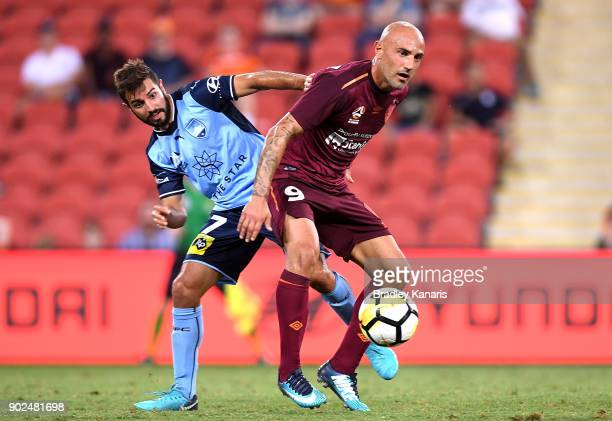 Massimo Maccarone of the Roar and Michael Zullo of Sydney challenge for the ball during the round 15 ALeague match between the Brisbane Roar and...