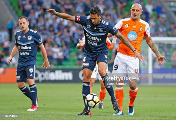 Massimo Maccarone of the Roar and Rhys Williams of the Victory compete for the ball during the round 20 ALeague match between the Melbourne Victory...