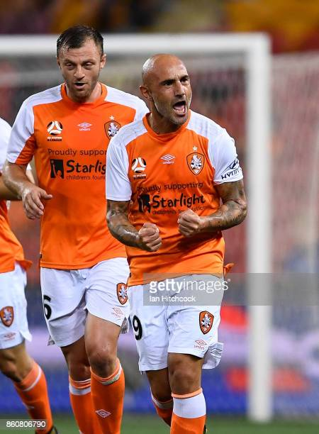 Massimo Maccarone of the Roar celebrates after scoring during the round two ALeague match between the Brisbane Roar and Adelaide United at Suncorp...