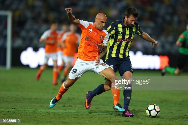 Massimo Maccarone of the Roar contests the ball with Antony Golec of the Mariners during the round 18 ALeague match between the Central Coast...