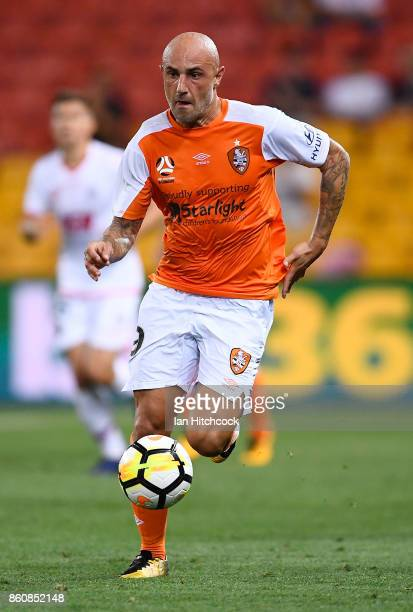 Massimo Maccarone of the Roar dribbles the ball during the round two ALeague match between the Brisbane Roar and Adelaide United at Suncorp Stadium...