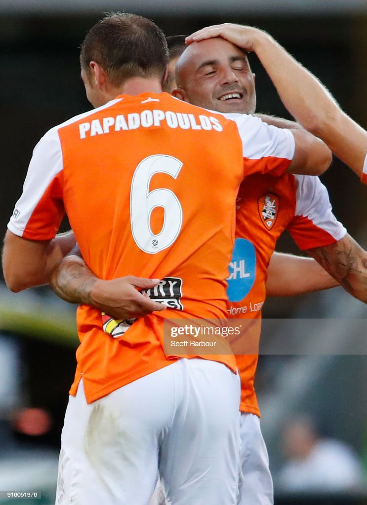 Massimo Maccarone of the Roar is congratulated by his teammates after scoring the Roars first goal during the round 20 A-League match between the Melbourne Victory and the Brisbane Roar at AAMI Park on February 9, 2018 in Melbourne, Australia.