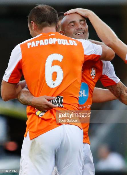Massimo Maccarone of the Roar is congratulated by his teammates after scoring the Roars first goal during the round 20 ALeague match between the...