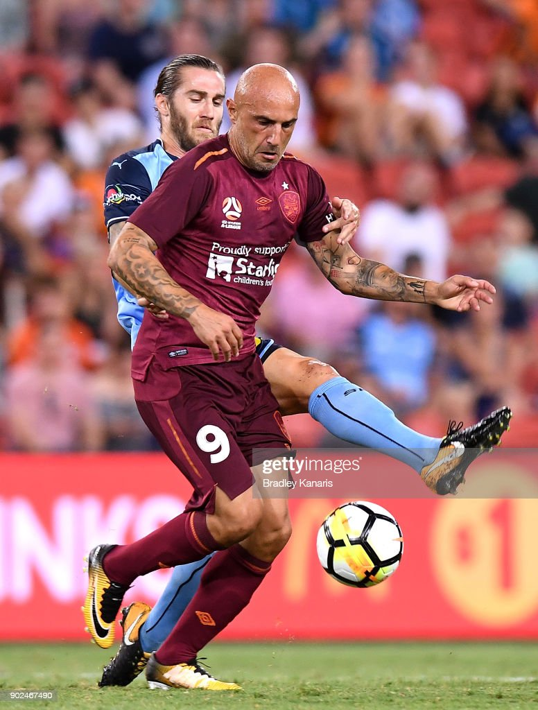 Massimo Maccarone of the Roar is pressured by the defence of Joshua Brillante of Sydney during the round 15 A-League match between the Brisbane Roar and Sydney FC at Suncorp Stadium on January 8, 2018 in Brisbane, Australia.