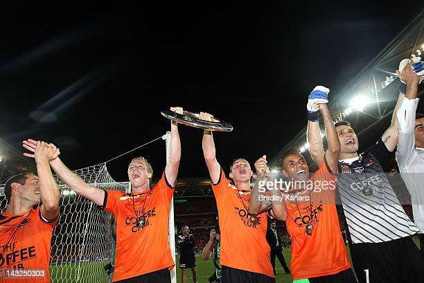 Massimo Murdocca Mitchell Nichols Nick Fitzgerald Henrique and Michael Theoklitos of the Roar celebrate victory after the 2012 ALeague Grand Final...