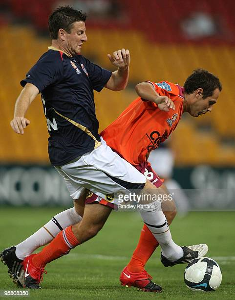 Massimo Murdocca of the Roar and Michael Bridges of the Jets compete for the ball during the round 23 ALeague match between the Brisbane Roar and the...