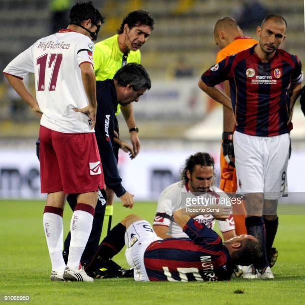 Massimo Mutarelli of Bologna lies injured after clashing with Davide Marchini of Livorno during the Serie A match between Bologna FC and AS Livorno...