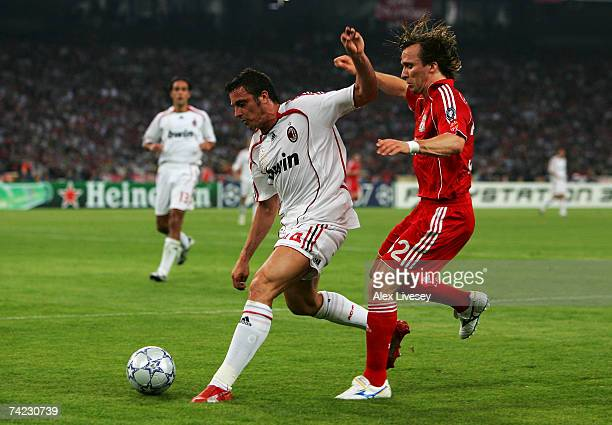 Massimo Oddo of Milan holds off the challenge from Boudewijn Zenden of Liverpool during the UEFA Champions League Final match between Liverpool and...