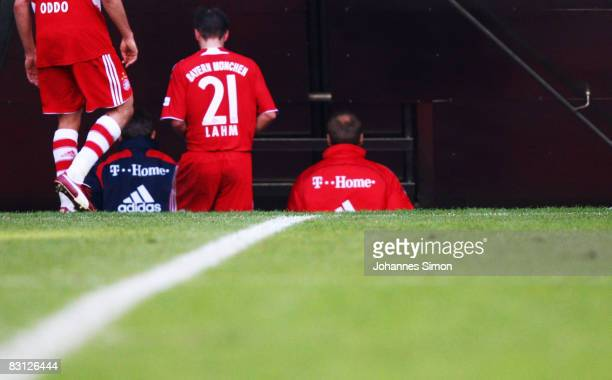 Massimo Oddo Philipp Lahm and Uli Hoeness manager of Bayern leave the pitch after the Bundesliga match between Bayern Muenchen and VfL Bochum at the...