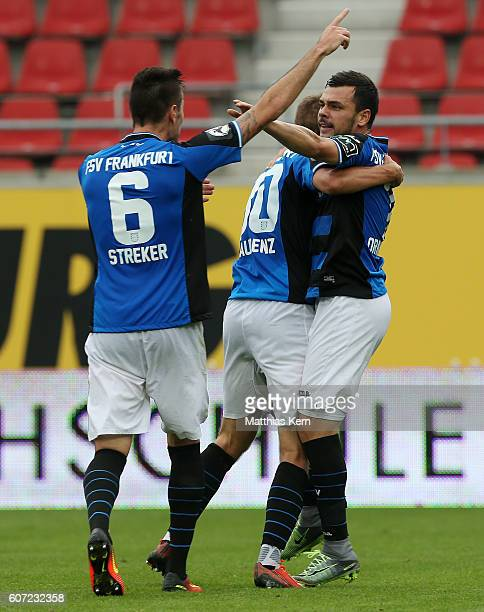 Massimo Ornatelli of Frankfurt jubilates with team mates after scoring the first goal during the third league match between Hallescher FC and FSV...