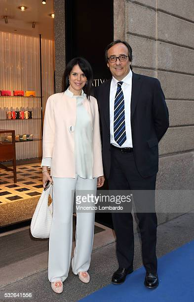 Massimo Perotti and his wife attend the Montenapoleone Yacht Club Opening Cocktail in via Montenapoleone luxury district on May 18 2016 in Milan Italy