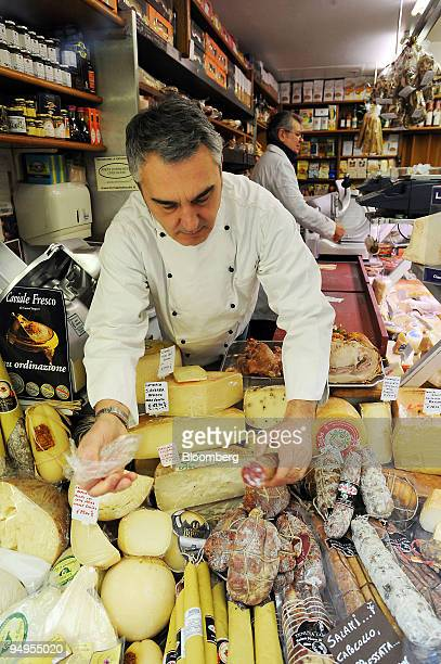 Massimo Rietti arranges food products in his delicatessen in central Rome Italy on Tuesday March 24 2009 Italy is due to release consumer confidence...