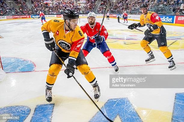 Massimo Ronchetti of HCL Jamie Tardif of Adler during the Champions Hockey League match between Adler Mannheim and HC Lugano at SAP on August 18 2016...