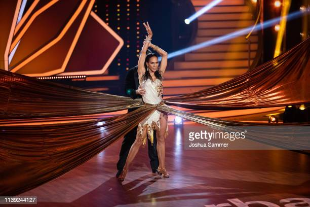 Massimo Sinato and Barbara Becker perform on stage during the 2nd show of the 12th season of the television competition Let's Dance on March 29 2019...
