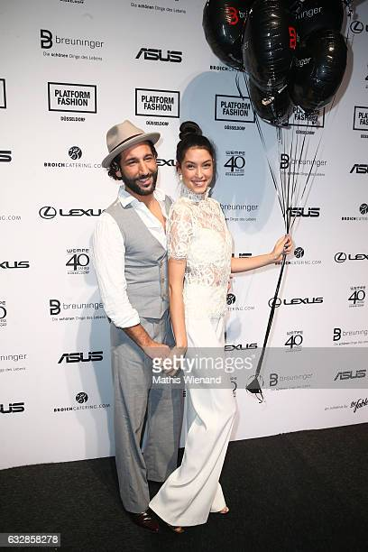 Massimo Sinato and Rebecca Mir attend the Breuninger show during Platform Fashion January 2017 at Areal Boehler on January 27, 2017 in Duesseldorf,...