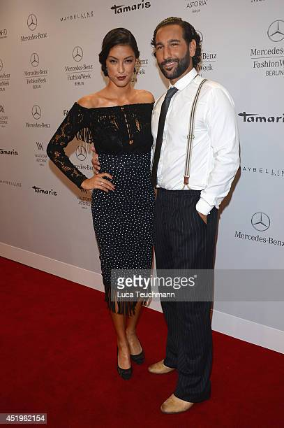 Massimo Sinato and Rebecca Mir attend the Laurel show during the MercedesBenz Fashion Week Spring/Summer 2015 at Erika Hess Eisstadion on July 10...