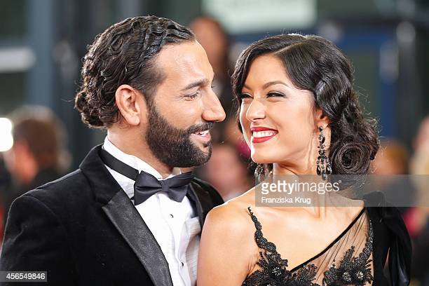 Massimo Sinato and Rebecca Mir attend the red carpet of the Deutscher Fernsehpreis 2014 on October 02 2014 in Cologne Germany