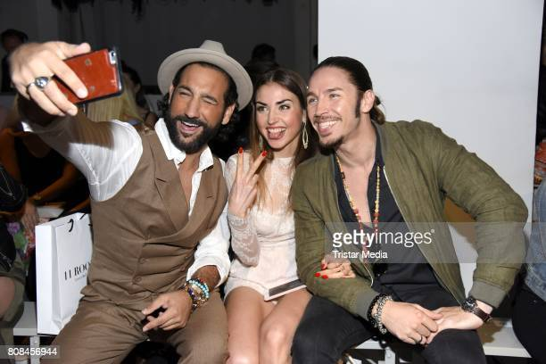 Massimo Sinato, Ekaterina Leonova and Gil Ofarim attend the Ewa Herzog show during the Mercedes-Benz Fashion Week Berlin Spring/Summer 2018 at...