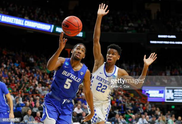 Massinburg of the Buffalo Bulls handles the ball against Shai GilgeousAlexander of the Kentucky Wildcats during the first half in the second round of...