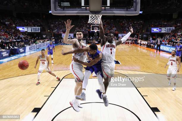Massinburg of the Buffalo Bulls passes the ball against Dusan Ristic and Rawle Alkins of the Arizona Wildcats during the first round of the 2018 NCAA...