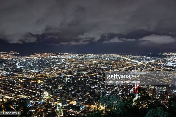 massive aerial skyline of bogota illuminated at night in colombia - diminishing perspective stock pictures, royalty-free photos & images