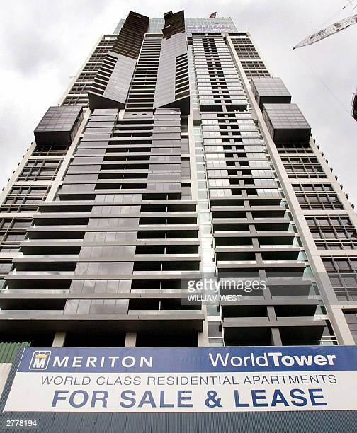 Massive apartment blocks in Sydney's central business district are advertised for sale as the Reserve Bank of Australia raised its interest rates for...