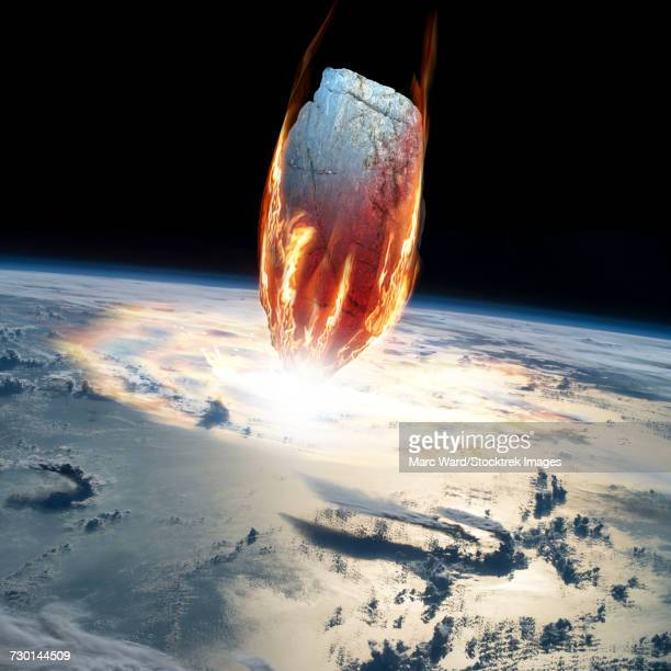 a massive asteroid enters earths atmosphere and impacts the planet. - asteroide foto e immagini stock