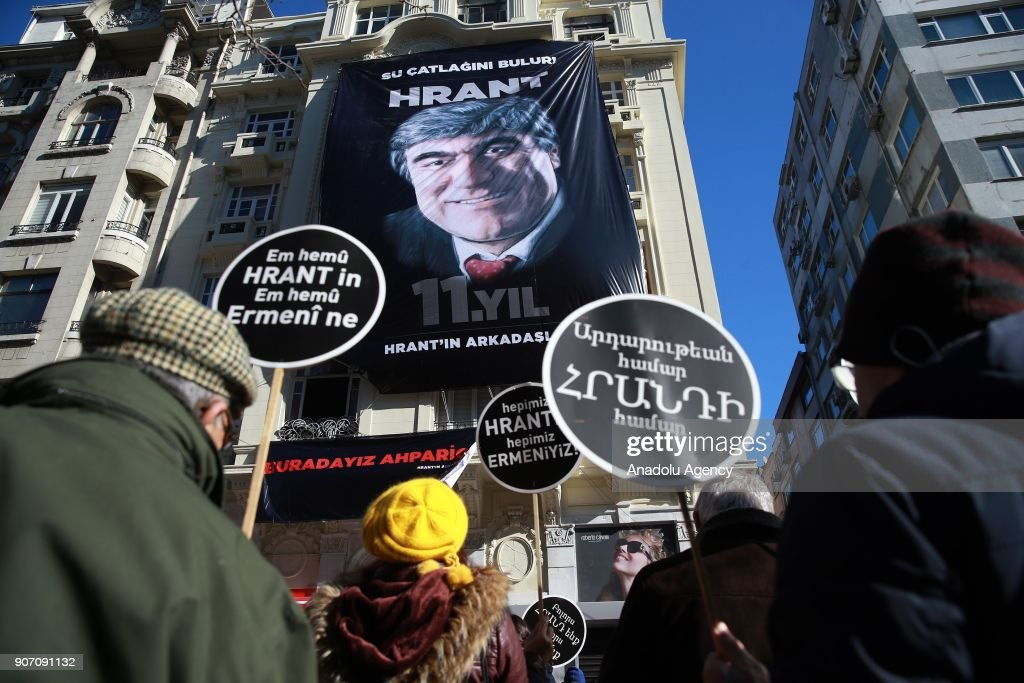 A massive banner with an image of Hrant Dink hangs down from a building during a commemoration ceremony in front of Agos newspaper building on the 11th death anniversary of Hrant Dink, former editor-in-chief of the bilingual Turkish-Armenian newspaper Agos, in Istanbul, Turkey on January 19, 2018. He was assassinated in front of the Agos newspaper building in Istanbul in 2007.