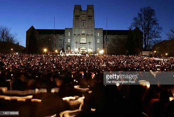 A massive candlelight vigil is held on the drill field in front of Burruss Hall the center piece of the Virginia Tech campus