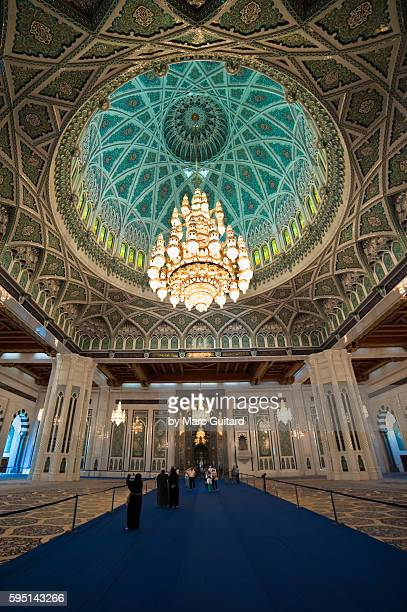 A massive chandelier hangs from the roof of the main prayer hall in Sultan Qaboos Grand Mosque, Muscat, Oman