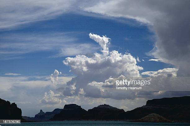 massive clouds above rock formations and lake - timothy hearsum stock pictures, royalty-free photos & images