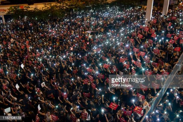 A massive crowd of protesters with flash lights and placards during the demonstration Thousands of people take part in a rally in Hong Kong against...