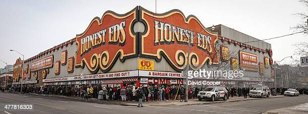 TORONTO ON MARCH 10 A massive crowd of shoppers nearly encircled the block around Honest Ed's waiting patiently for their turn to go inside and...