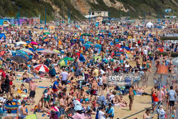 Massive crowds gather on Bournemouth beach making Social distancing very difficult on May 31, 2020 in Bournemouth, England. The British government...