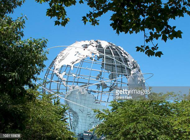 massive earth globe in treed area. - flushing queens stock pictures, royalty-free photos & images