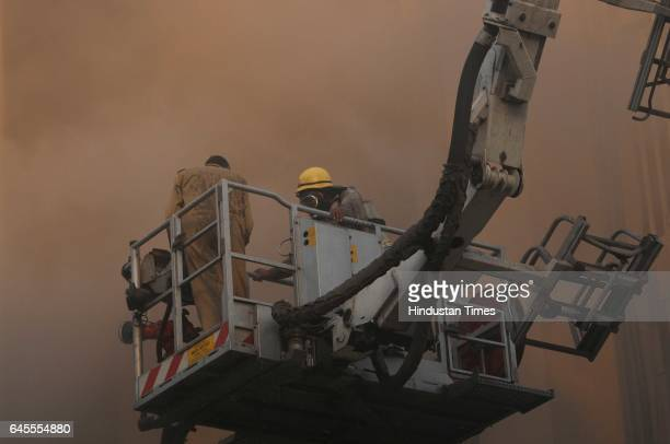 Massive fire breaks out at the Times of India building in Bahadur Shah Zafar Marg, on February 26, 2017 in New Delhi, India. 31 fire tenders were...