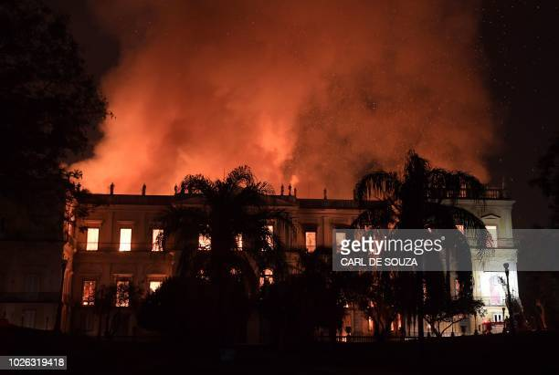 TOPSHOT A massive fire engulfs the National Museum in Rio de Janeiro one of Brazil's oldest on September 2 2018 The cause of the fire was not yet...