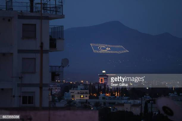 Massive flag of the self-proclaimed Turkish Republic of North Cyprus lies illuminated on a mountainside on the Turkish, northern part of the island...