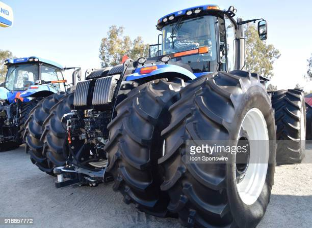 Massive front tires provide plenty of traction on the New Holland T9 600 tractor on display during the 51st World Ag Expo on February 13 2018 at the...